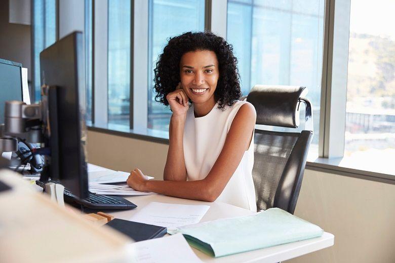 Lady at desk smiling