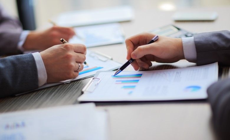 Two business professionals reviewing a document