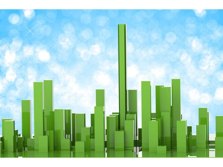A computer animated image of a green landscape of a city