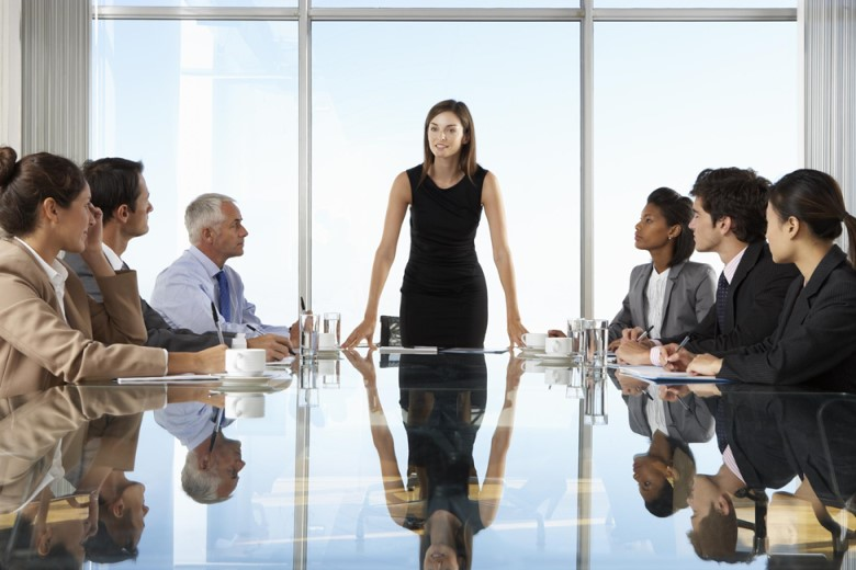 Female CEO presenting in front of table