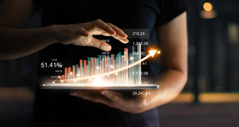 Businessman holds holographic statistics graph