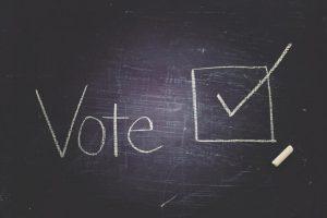 """""""Vote"""" written in chalk on chalkboard"""