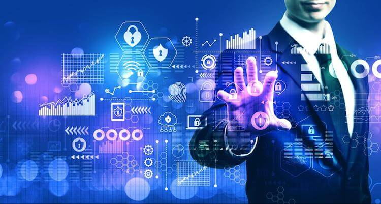 Businessman surrounded by virtual business intelligence and data analytics icons
