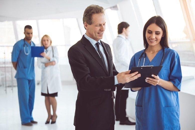 Healthcare professionals standing in a hospital corridor