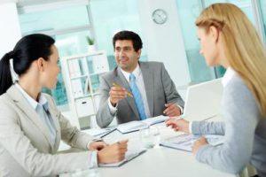 A CEO leads a team meeting.