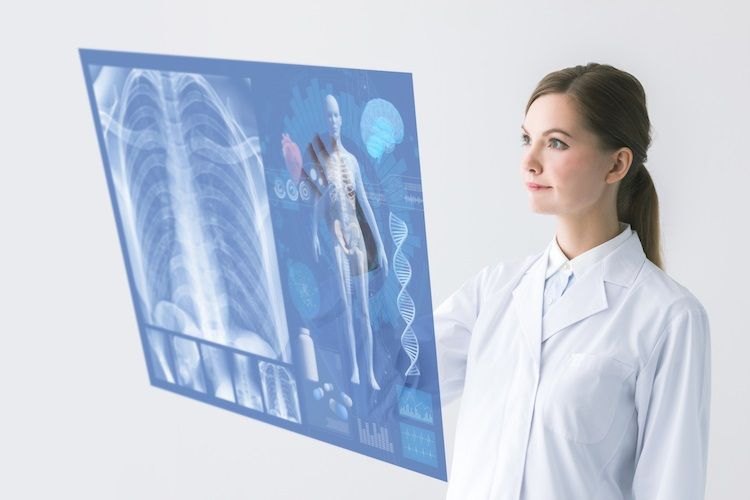 A female healthcare professional looking at an interactive X-ray