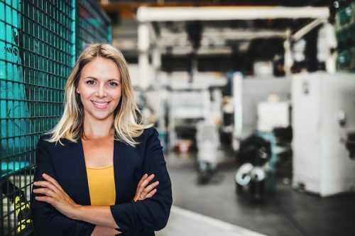 Engineering manager poses in her workplace.
