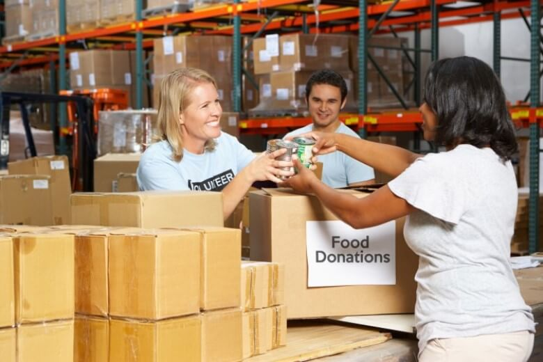 Nonprofit organization volunteers accept food donations
