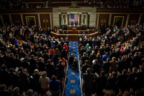 Gathered members of Congress inside the House of Representatives at the U.S. Capitol