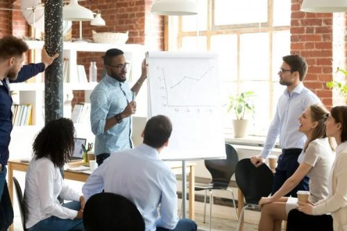 A sales manager discusses results with team members.