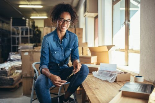 Small business owner filling online orders