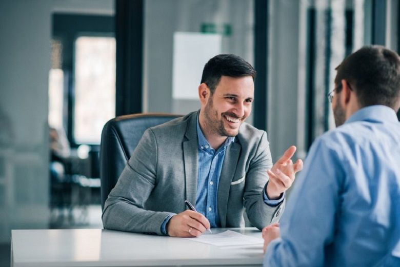 A financial planner meets with a client.
