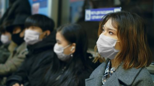 Masked passengers ride the subway during the COVID-19 pandemic