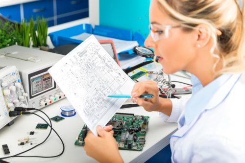 An electrical engineer studies a circuit diagram.