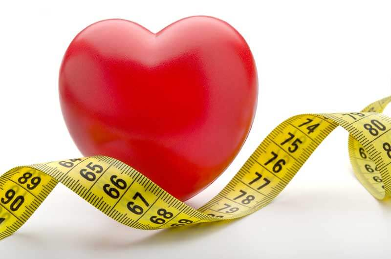 A red heart and a measuring tape