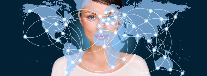 Picture of a woman with a map of the world overlaying her face