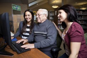 Healthcare social workers helping patient sign up for health insurance