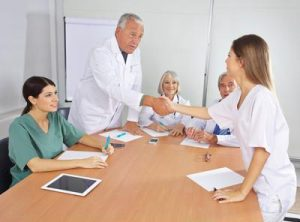 health professionals sitting at a table
