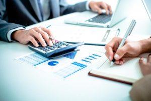 Accountant crunching numbers
