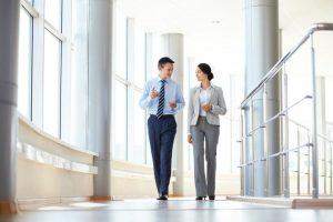 professionals discuss their work in hallway