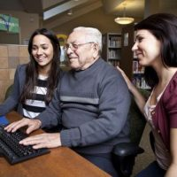 Social workers help elderly man sign up for health benefits