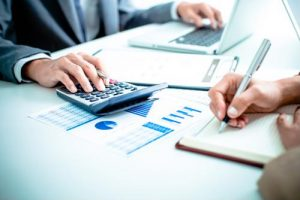 Business systems analysts review an IT budget