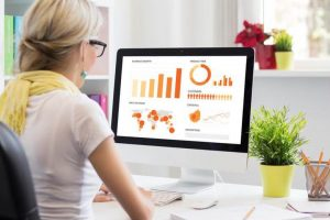 Business process analyst reviews business metrics