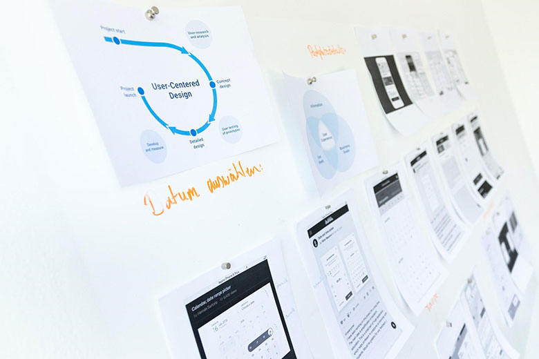An array of data visualizations displayed on a white pinboard