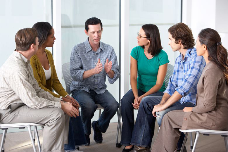 Clinical social worker leads a group therapy session