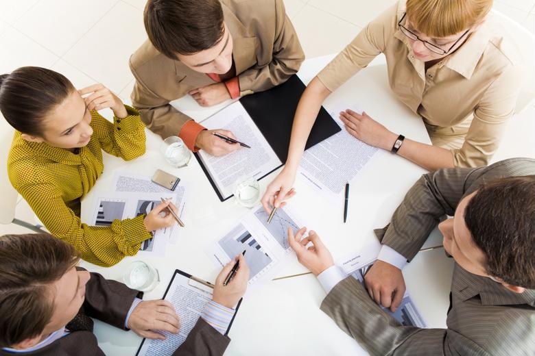 Market research analysts discuss sales metrics