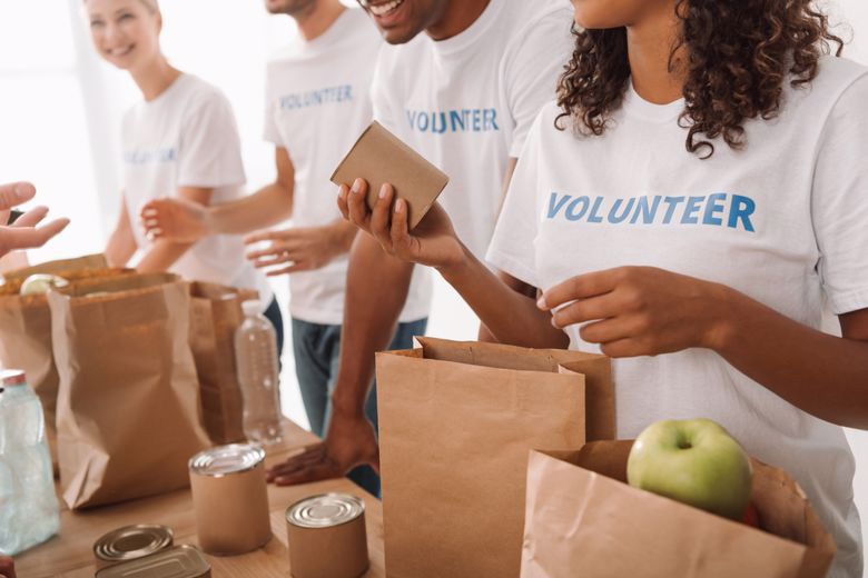 Community health workers volunteer at a food drive