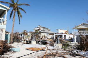A residential area littered from debris after a hurricane.
