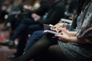 girl sitting in conference