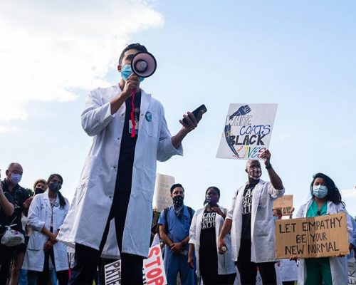 doctors showcasing social justice in healthcare