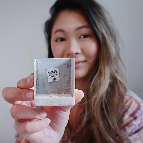 Ngoc Huynh holding miniature