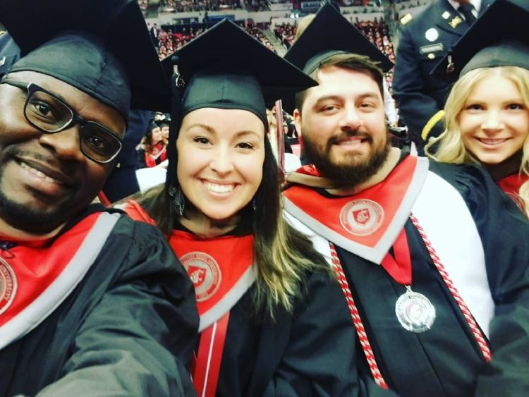 WSU Online MBA students smile at graduation