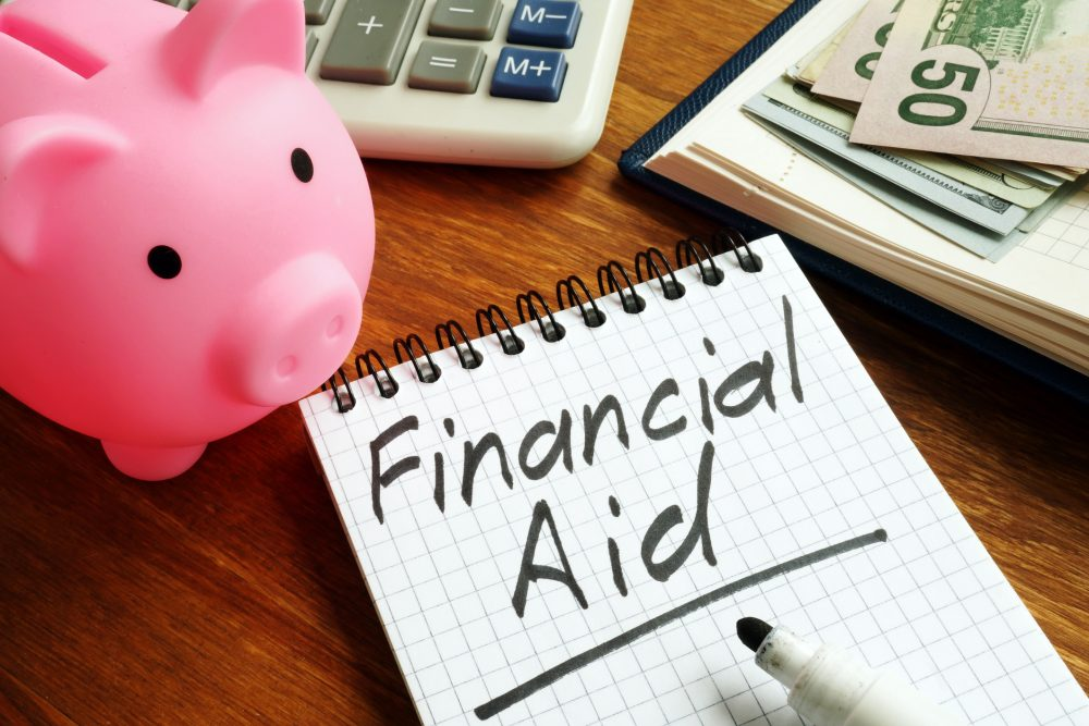Financial aid can help lower the costs of obtaining an advanced business degree.