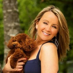 Heather Bobzin poses outside with her dog.