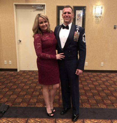 Heather Bobzin poses with her husband at a formal event where he's wearing his military uniform.