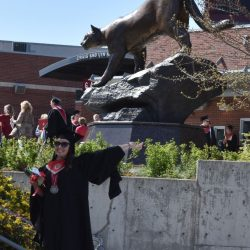 WSU Online MBA student, Cathryn Curry Hasz, smiles at graduation