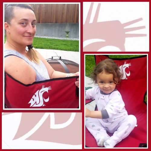 Alexis Mohr, a WSU online mba student, sits outside with young child in WSU chairs