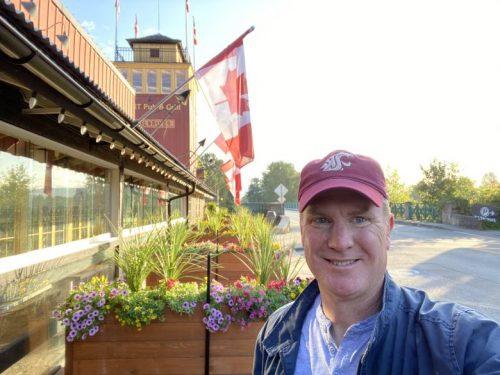 Shane Sullivan, WSU online EMBA student, smiles in Canada