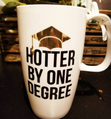 """Hotter by one degree"" coffee mug with graduation cap"
