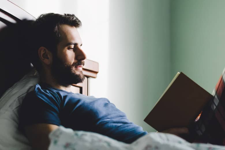 Man reading in bed