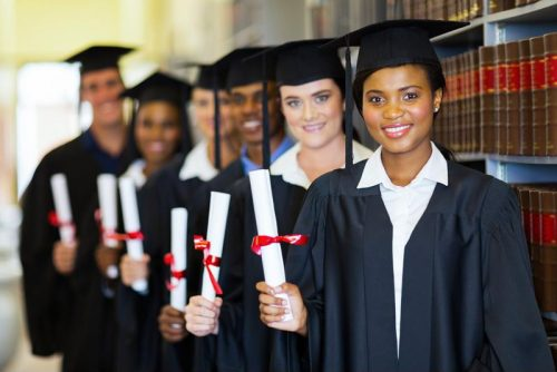Group of recent graduates holding diplomas