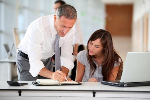 Male employer training female intern