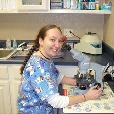 Jenna, reading a sample under the microscope.