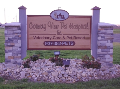 Country view pet hospital sign
