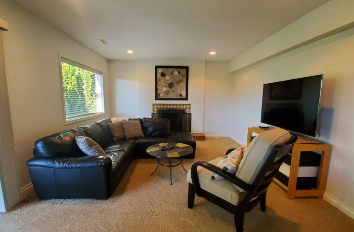 Living Room with Gas Fireplace and 52 inch TV with Cable