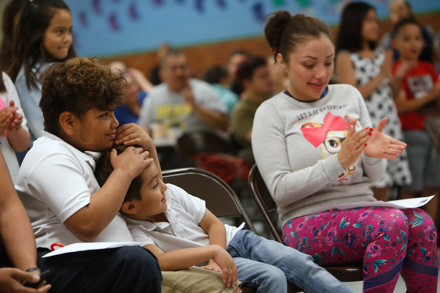 Luis Garcia, left, hugs his brother Rafael during a ceremony to recognize his heroism. Officials from Culberson County traveled to Putnam Elementary School to present Luis with a Heroism Certificate for his actions in helping his brother and mother after a fiery crash near Van Horn. -Photo courtesy of EPISD